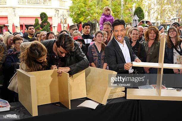 Maria Menounos Jonathan Scott and Mario Lopez build a bookshelf at Extra at The Grove on February 19 2013 in Los Angeles California