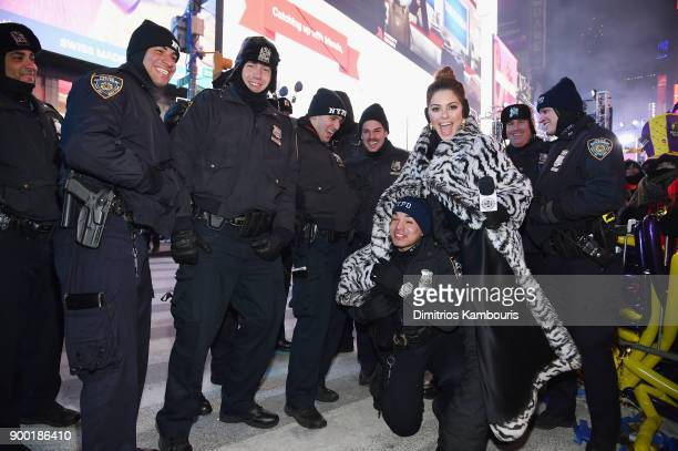 Maria Menounos keeps an NYPD officer warm before her wedding ceremony during Maria Menounos and Steve Harvey Live from Times Square at Marriott...