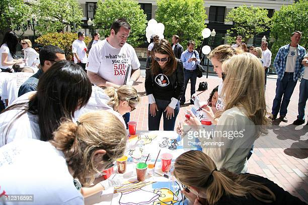 Maria Menounos paints with volunteers during Maria Menounos Celebrates Volunteerism With Levi's Jeans on 501 Day at Levi's Headquarters and Store in...