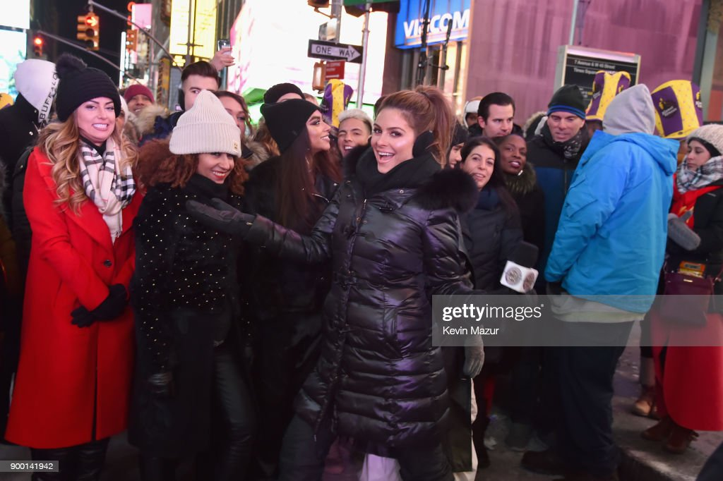Maria Menounos poses with attendees at the Dick Clark's New Year's Rockin' Eve with Ryan Seacrest 2018 on December 31, 2017 in New York City.