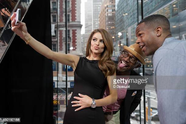 "Maria Menounos, Taye Diggs, and AJ Calloway visit ""Extra"" at their New York studios at H&M in Times Square on June 5, 2014 in New York City."