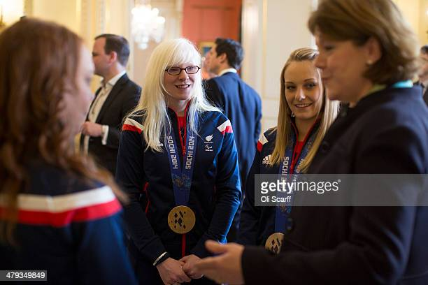 Maria Miller Secretary of State for Culture Media and Sport greets members of the Winter Paralympic Team GB including gold medal winning skiers Kelly...
