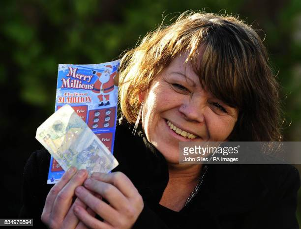 Maria Murray from Avonmouth Bristol celebrates her one million pound scratchcard win at a presentation ceremony near Doncaster