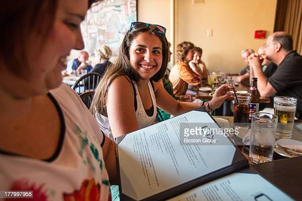 Maria Pacheco, left, and her daughter Kayla enjoy dinner at Blue Ox in Lynn.