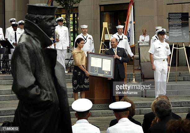 Maria Paz Leveque wife of Navy SEAL Danny Dietz receives the Navy Cross from Secretary of the Navy Donald Winter during a ceremony posthumously...