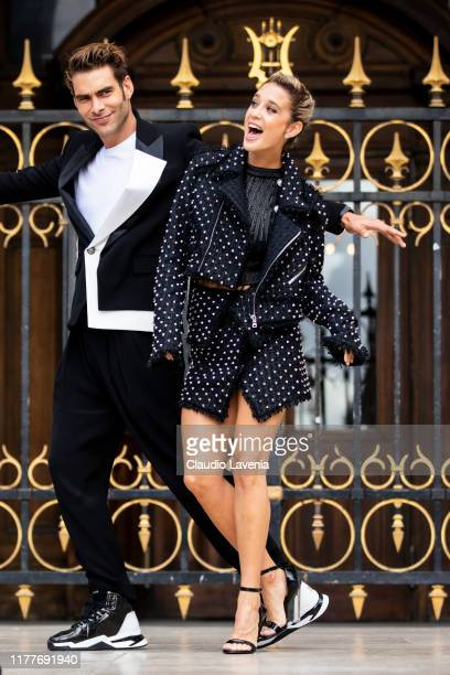Maria Pedraza wearing a black top black studded jacket and matching skirt and Jon Kortajarena wearing a black suit with white details and black...