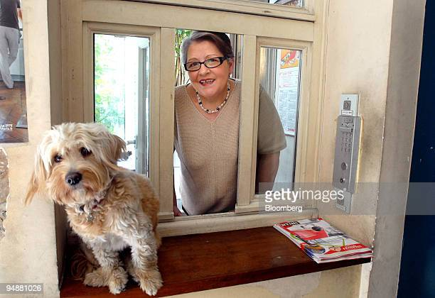 Maria Pereira a concierge in Paris poses in her lodge with her dog Paco in Paris France on Thursday June 26 2008 The concierge is becoming a casualty...