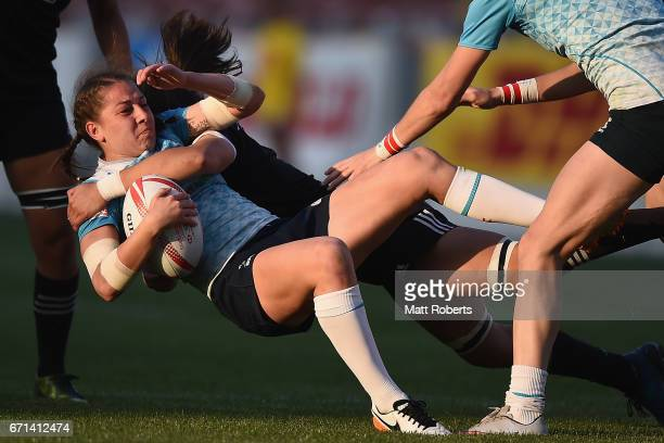 Maria Perestiak of Russia is tackled during the HSBC World Rugby Women's Sevens Series 2016/17 Kitakyushu pool match between New Zealand and Russia...