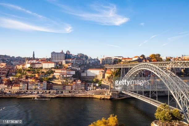 maria pia bridge over the douro river, at porto, portugal - ポルトガル ポルト ストックフォトと画像