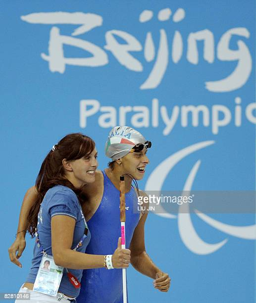 Maria Poiani Panigati of Italy celebrates with her trainer after winning the women's 50m freestyle S11 final during the 2008 Beijing Paralympic Games...