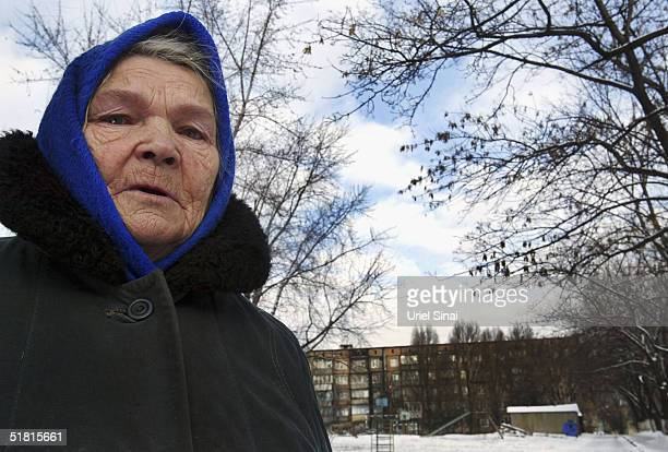 Maria Prokopvich is seen near to the three roomed apartment which she shares with her 54 year old son Vladimir and another family December 2 2004 in...
