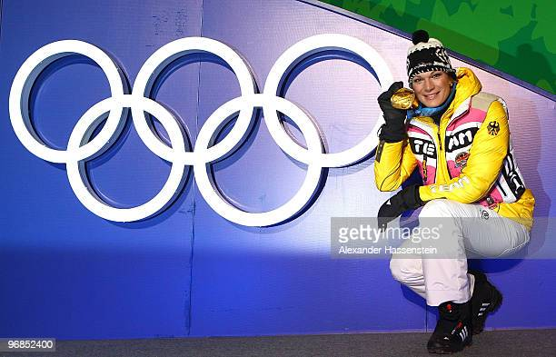Maria Riesch of Germany celebrates winning the gold medal during the medal ceremony for the Ladies' Super Combined on day 7 of the Vancouver 2010...