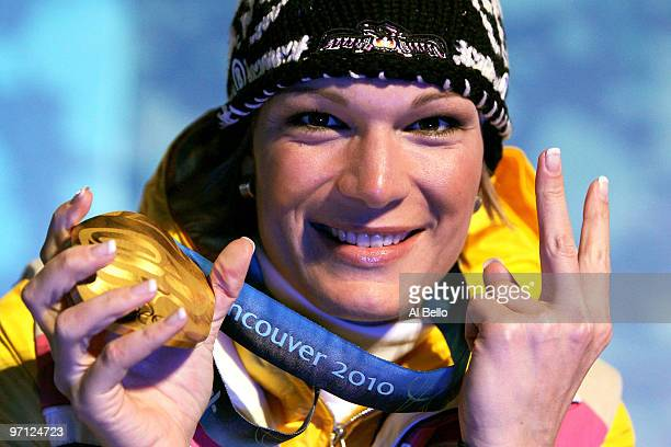 Maria Riesch of Germany celebrates winning the gold medal during the medal ceremony for the ladies alpine skiing slalom on day 15 of the Vancouver...