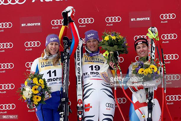 Maria Riesch of Germany takes 1st place Ingrid Jacquemod of France takes 2nd place Fabienne Suter of Switzerland takes 3rd place during the Audi FIS...