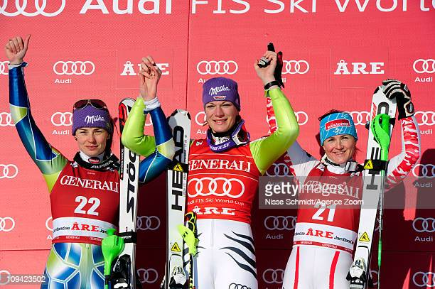 Maria Riesch of Germany takes 1st place Tina Maze of Slovenia takes 2nd place Elisabeth Goergl of Austria takes 3rd place during the Audi FIS Alpine...