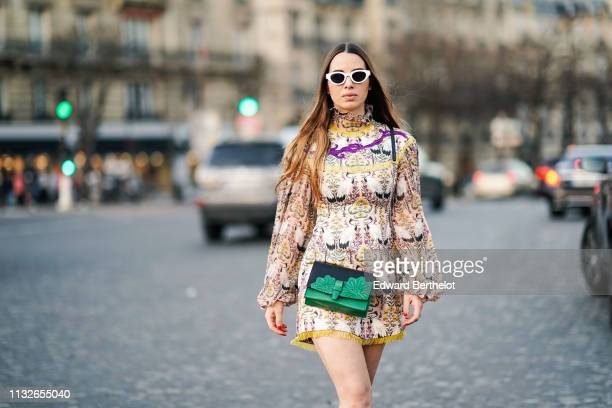 Maria Rizzo wears sunglasses a multicolor geometric pattern floral print a green bag Fendi shoes outside Rochas during Paris Fashion Week Womenswear...