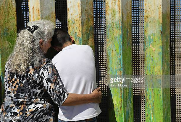 Maria Rodriguez Torres embraces a grandchild after seeing her other grandchildren for the first time through the USMexico border fence on September...