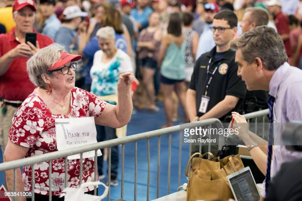 Maria Rojas shouts at Jim Acosta of CNN before a campaign rally for Governor Henry McMaster featuring President Donald Trump June 25 2018 in Columbia...