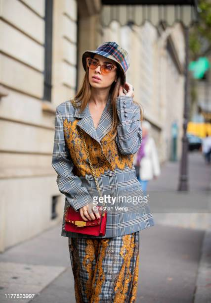 Maria Rosaraia Rizzo seen wearing Rahul Mishra total look, two tone pants and blazer, Marella bag, Anthony Peto hat, Shelter sunglasses outside...