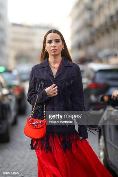 "Maria Rosaria Rizzo aka ""La Coquette Italienne"" wears a red dress from Parosh, a dark navy blue jacket with long fringes and pockets from Parosh, a..."