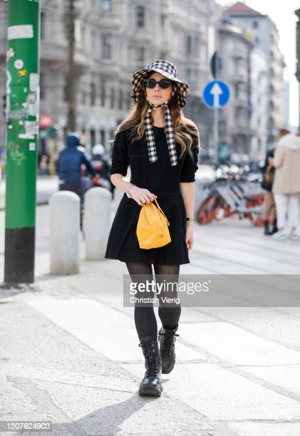 Maria Rosaria Rizzo is seen wearing checkered floppy hat other stories yellow Prada bag black dress Giovanni Bedin sheer tights laced boots Prada...