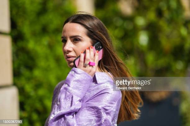 Maria Rosaria Rizzo @lacoquetteitalienne wears a pale purple belted oversized MSGM silk shirt, a silver heart ring, a pink ring, on May 23, 2021 in...