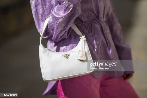 Maria Rosaria Rizzo @lacoquetteitalienne wears a pale purple belted oversized MSGM silk shirt, pink flower pattern silk MSGM flared pants, a white...