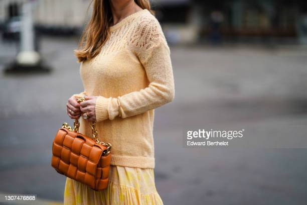 Maria Rosaria Rizzo @lacoquetteitalienne wears a pale yellow wool pullover with embroidery from L'Imprévu, a yellow short pleated mesh skirt from...