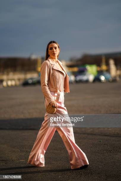 Maria Rosaria Rizzo @lacoquetteitalienne wears a pink studded leather jacket, a white low-neck crop top, a Valentino belt, a Chanel round quilted...