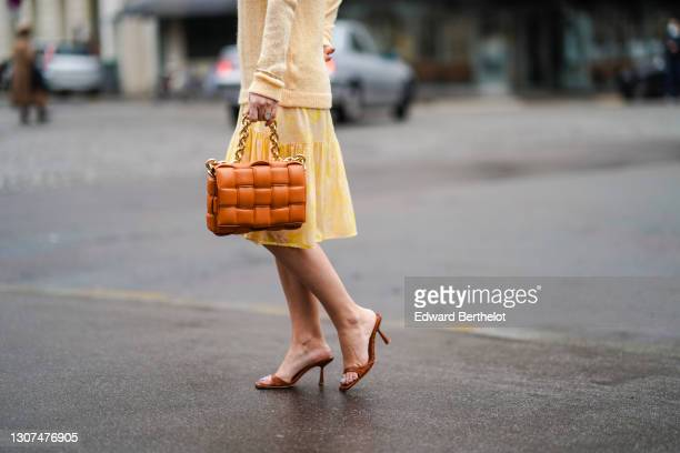 Maria Rosaria Rizzo @lacoquetteitalienne wears a ring, a pale yellow wool pullover with embroidery from L'Imprévu, a yellow short pleated mesh skirt...