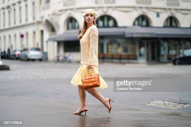 Maria Rosaria Rizzo @lacoquetteitalienne wears a yellow wool beret hat from & Other Stories, a pale yellow wool pullover with embroidery from...