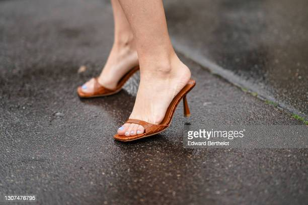 Maria Rosaria Rizzo @lacoquetteitalienne wears brown leather sandals shoes with crocodile pattern from Song of Style, on March 04, 2021 in Paris,...