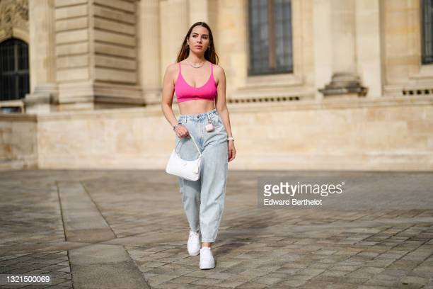 Maria Rosaria Rizzo @lacoquetteitalienne wears gold earrings, a multicolor Love slogan necklace, a pink fushcia bra underwear from Pimkie, blue faded...
