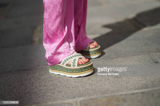 Maria Rosaria Rizzo @lacoquetteitalienne wears pink flower pattern silk MSGM flared pants, khaki suede strappy and white seams Mou sandals platform...