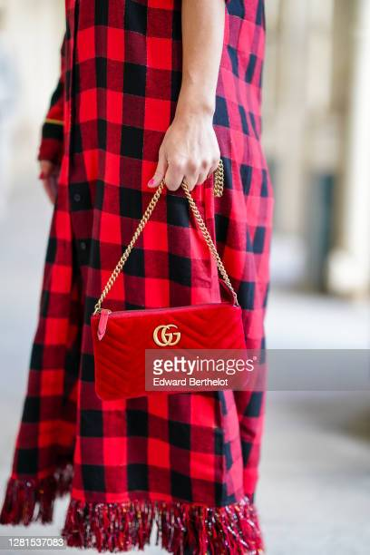 Maria Rosaria Rizzo wears a black and red checkered shirt / long dress with fringes a red velvet padded Gucci bag on October 21 2020 in Paris France