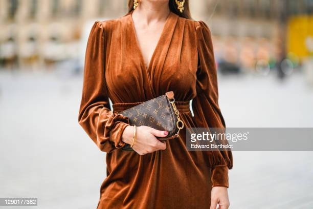 Maria Rosaria Rizzo wears a brown leather monogram Vuitton bag, a brown velvet low-neck v-neck dress from Imprevu, on December 04, 2020 in Paris,...