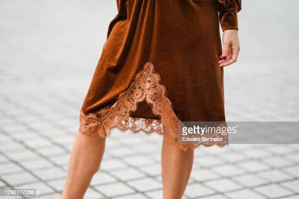Maria Rosaria Rizzo wears a brown velvet dress with lace and floral embroidery on the bottom part from Imprevu, brown high heeled shoes from Michael...