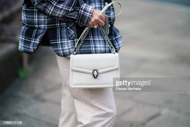 Maria Rosaria Rizzo wears a Bulgari bag, on November 29, 2020 in Paris, France.