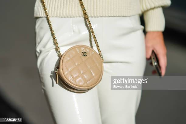 Maria Rosaria Rizzo wears a white wool pullover from Son Trava, white leather pants from LPA, a beige circular small Chanel bag, on October 26, 2020...