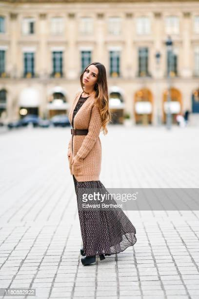 Maria Rosaria Rizzo wears brown wool jacket a large belt a dress with a printed geometric patterns on October 13 2019 in Paris France