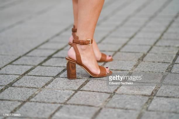 Maria Rosaria Rizzo wears leather brown high heeled shoes from Michael Kors, on December 04, 2020 in Paris, France.