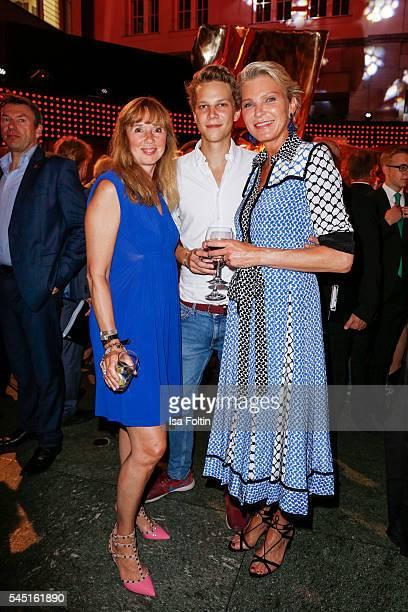 Maria S Koteneva Stephanie von Pfuel and her son attend the Deutscher Gruenderpreis on July 5 2016 in Berlin Germany