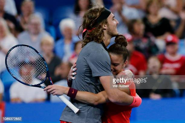 Maria Sakkari and Stefanos Tsitsipas of Greece embrace after defeating Belinda Bencic and Roger Federer of Switzerland in the mixed doubles match...