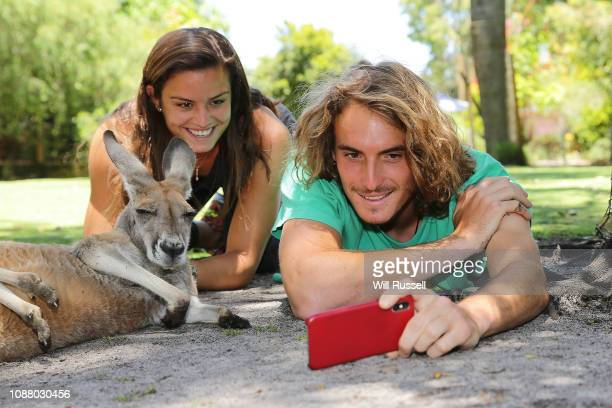 Maria Sakkari and Stefanos Tsitsipas of Greece take selfies with a Red kangaroo at Caversham Wildlife Centre during day two of the 2019 Hopman Cup at...