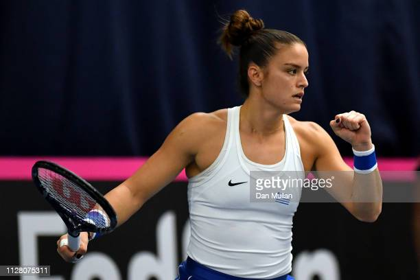 Maria Sakkari of Greece celebrates a set point during her Europe/Africa Group A match against Johanna Konta of Great Britain on Day Two of the Fed...
