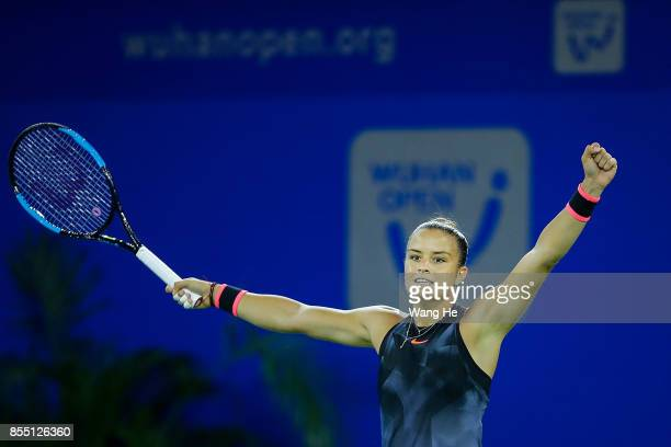 Maria Sakkari of Greece celebrates after defeating Alize Cornet of France on Day 5 of 2017 Dongfeng Motor Wuhan Open at Optics Valley International...