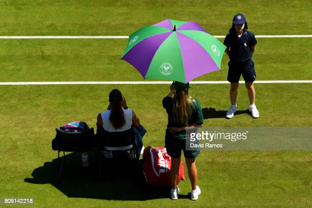 Maria Sakkari of Greece is shielded from the sun during the Ladies Singles second round match against Kristyna Pliskova of the Czech Republic on day...