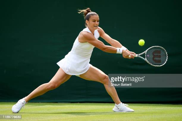 Maria Sakkari of Greece plays a backhand in her Ladies' Singles second round match against Marie Bouzkova of Czech Republic during Day three of The...