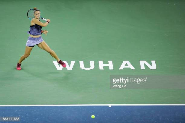 Maria Sakkari of Greece returns a shot during the match against Alize Cornet of France on Day 5 of 2017 Dongfeng Motor Wuhan Open at Optics Valley...