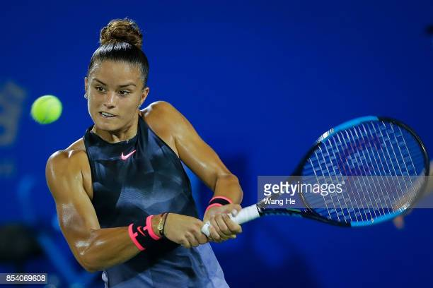 Maria Sakkari of Greece returns a shot during the match against Caroline Wozniacki of Denmark on Day 3 of 2017 Dongfeng Motor Wuhan Open at Optics...